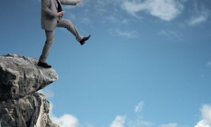 man-jumping-off-cliff